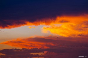 Beautiful Sunset With Colorful Orange, Yellow and Purple Clouds